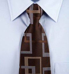 brown tie on blue shirt