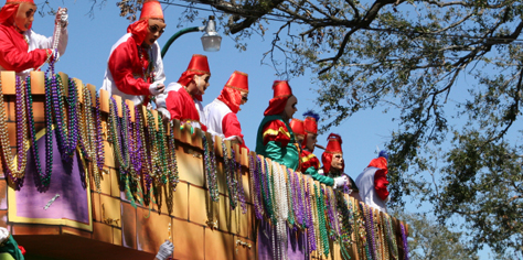 mardi gras float with beads