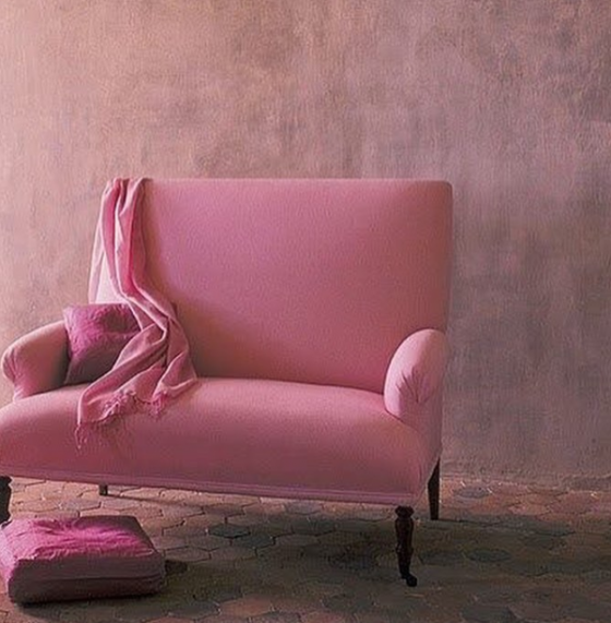 purple pillow and pink armchair